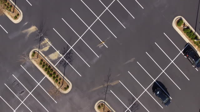pan across empty parking lot - car park stock videos & royalty-free footage