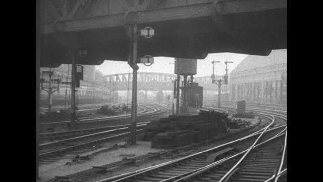pan across empty railroad tracks at paddington station during general strike in england / pan across trains sitting empty at train platforms / note... - 1926 stock videos & royalty-free footage