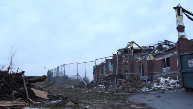 Pan Across Fenced Off Destroyed Building