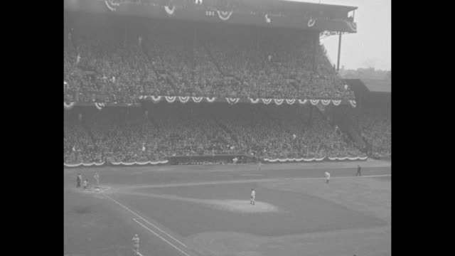 pan across field and stands of navin field / crowd stands up / shot of crowd in stands / pan across field and stands / st. louis cardinals' pitcher... - baseball world series stock videos & royalty-free footage