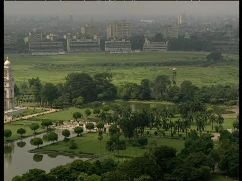 pan across gardens in front of victoria memorial in calcutta. - victoria memorial kolkata stock videos and b-roll footage