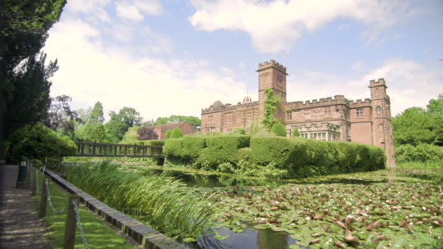 pan across historic castle with moat - moat stock videos & royalty-free footage