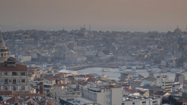 pan across istanbul's skyline showing the galata tower, the yeni mosque and the eminönü ferryboat docks, turkey. - yeni cami mosque stock videos and b-roll footage