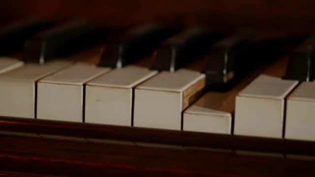 pan across keys of self-playing piano - piano key stock videos & royalty-free footage