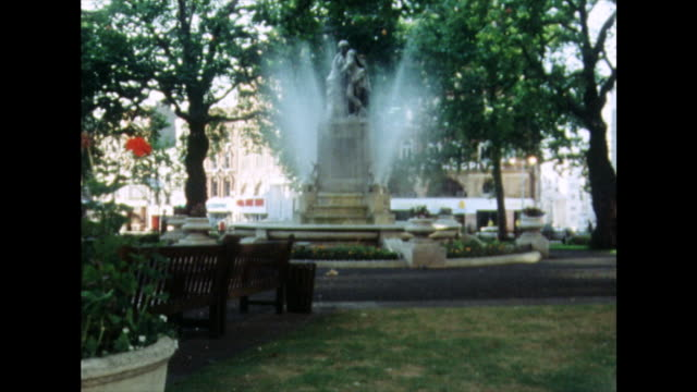 pan across leicester square gardens,london; 1975 - 1975 stock videos & royalty-free footage