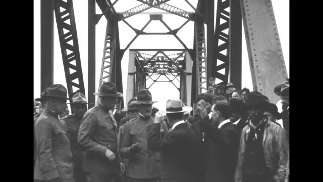 pan across line of officers standing with us general john j pershing / vs pershing and staff greet mexican officials on bridge at brownsville texas... - john pershing stock videos & royalty-free footage