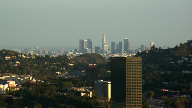 pan across los angeles from universal city, looking over the hollywood hills. - studio city stock videos & royalty-free footage