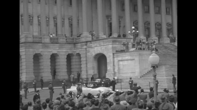 pan across members of us congress giving standing ovation to gen douglas macarthur who stands at lectern behind him are us vice president alben... - united states congress video stock e b–roll