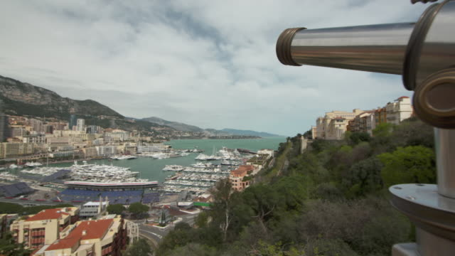pan across monte carlo city and busy port hercules harbour - monte carlo stock-videos und b-roll-filmmaterial