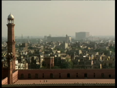 Pan across mosque with cityscape in background Lahore.