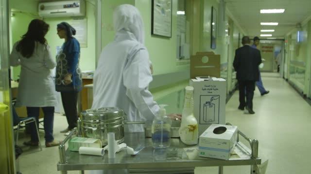pan across nurses and hospital hallway in baghdad - baghdad stock videos & royalty-free footage