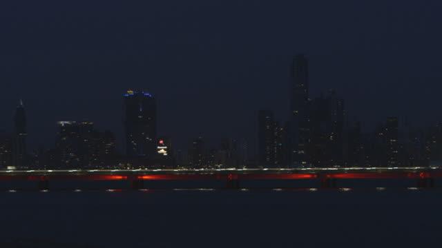 pan across panama city skyline at night, wide shot - panama city panama stock videos & royalty-free footage