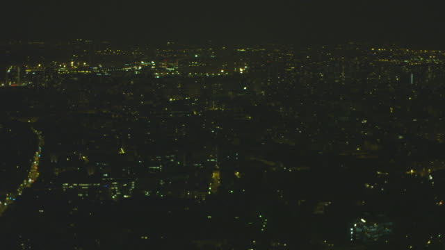 pan across paris' vast, twinkling, illuminated cityscape at night, france. - population explosion stock videos & royalty-free footage