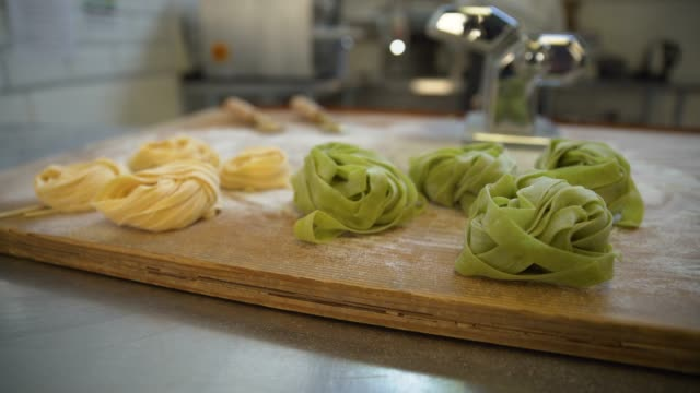 pan across pasta on wooden surface - comfort food stock videos & royalty-free footage