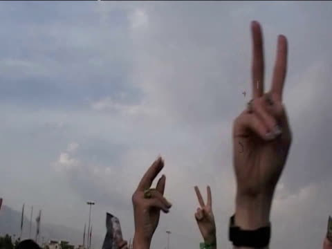 pan across protesters hands displaying peace signs following results of presidential elections 14 june 2009 - 2009 stock videos & royalty-free footage