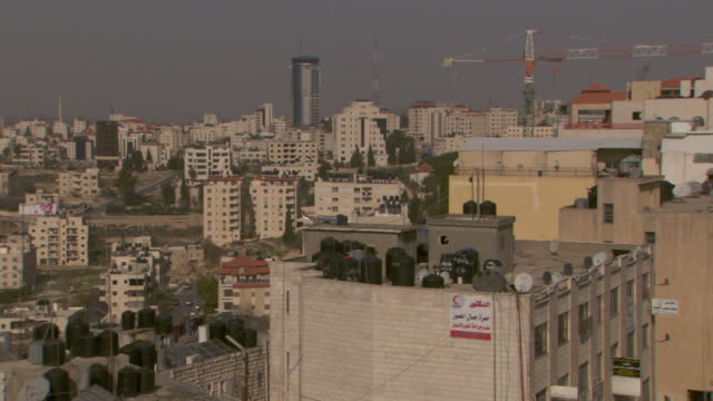 pan across ramallah's skyline west bank - ramallah stock videos and b-roll footage