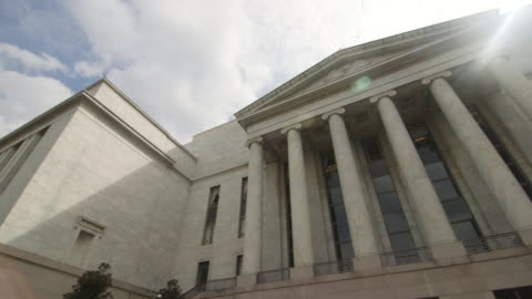 pan across rayburn house office building in dc - law stock-videos und b-roll-filmmaterial