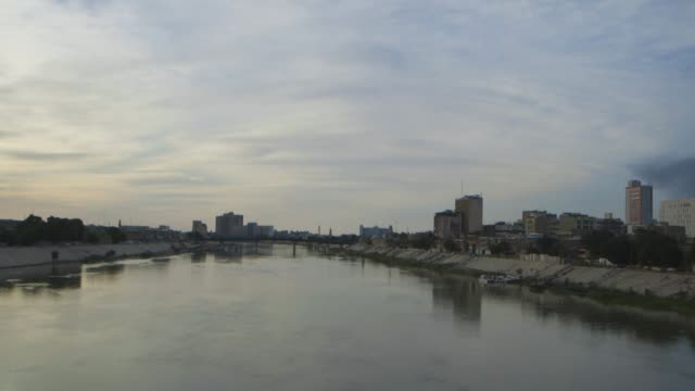 pan across river in baghdad, extreme wide shot - baghdad stock videos & royalty-free footage