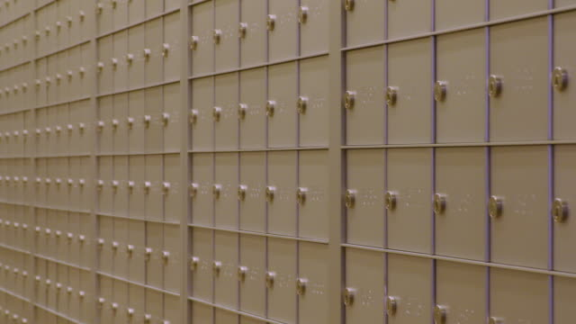pan across shot of mailboxes - post office stock videos and b-roll footage