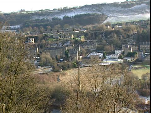 vídeos de stock e filmes b-roll de pan across small town on partially snow covered hillside yorkshire - yorkshire