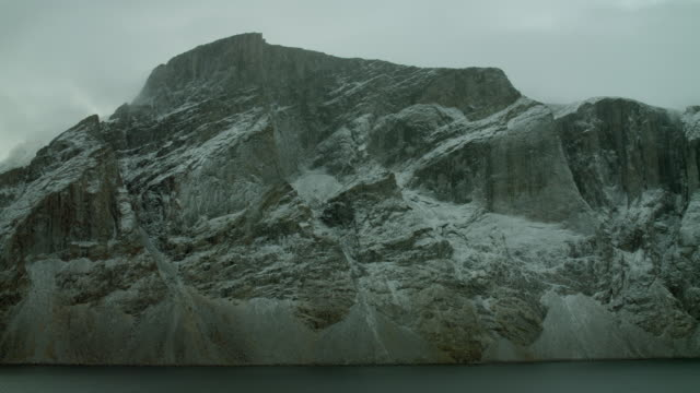 pan across snow dusted arctic headland - northwest passage stock videos and b-roll footage