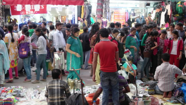 a pan across street vendors selling various textiles, shoes, jewellery and other personal items - pavement stock videos & royalty-free footage