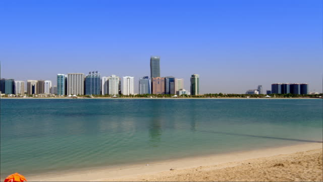 Pan across the Abu Dhabi beachfront and cityscape.