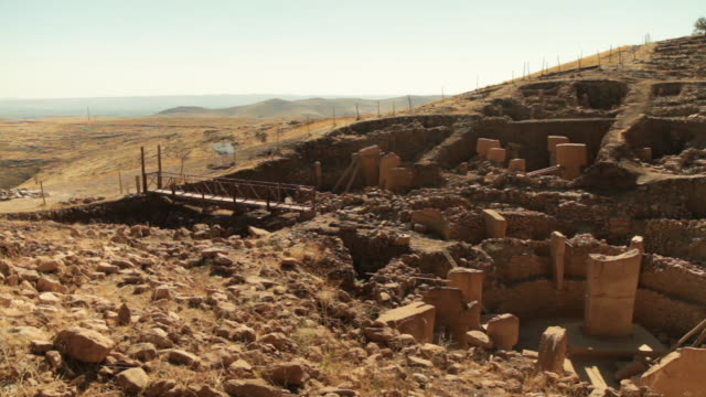 Pan across the archaeological excavation site at Gobekli Tepe, Turkey.
