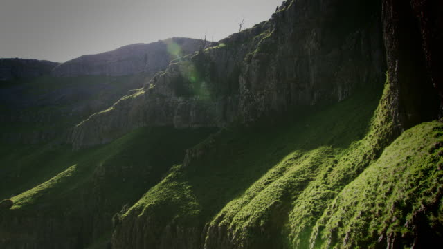 pan across the dramatic landscape of gordale scar in malham, north yorkshire. - scar stock videos and b-roll footage
