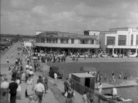 pan across the exterior of the casino and a boating lake on canvey island 1953 - casino stock videos & royalty-free footage