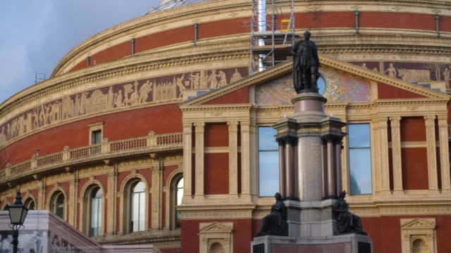 pan across the exterior of the royal albert hall in london's south kensington. - royal albert hall stock videos and b-roll footage