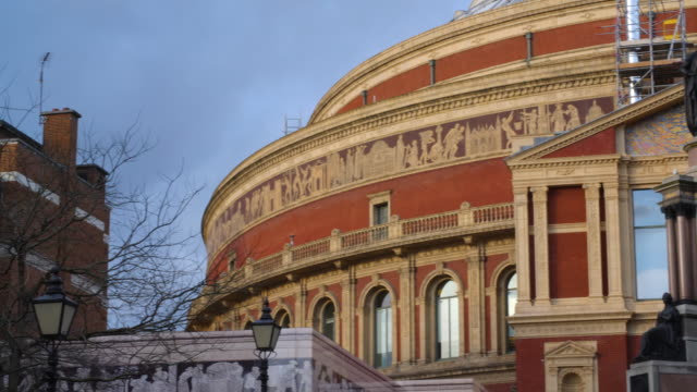pan across the exterior of the royal albert hall in london's south kensington. - royal albert hall stock videos & royalty-free footage