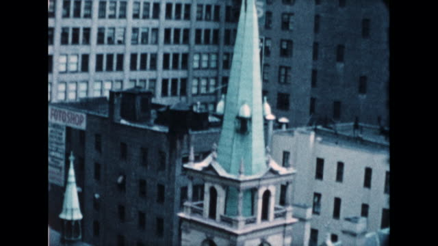 pan across the green steeple of a church in new york city. possibly is st. patricks church from the rear side. - steeple stock videos & royalty-free footage