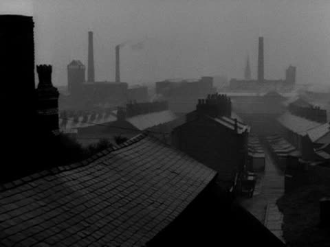 pan across the rooftops of slum houses in salford. - chimney stock videos & royalty-free footage