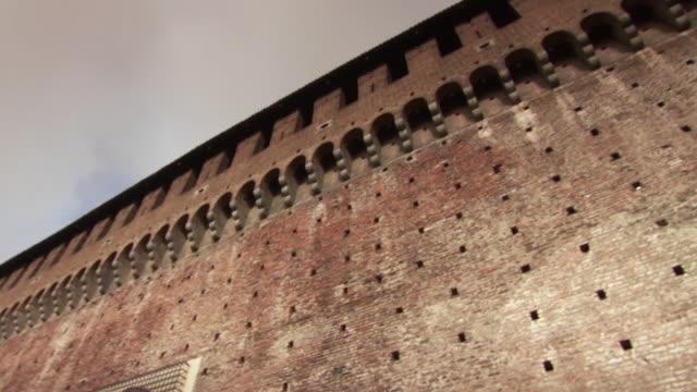 Pan across the striking ramparts of Milan's Sforza Castle, Italy.