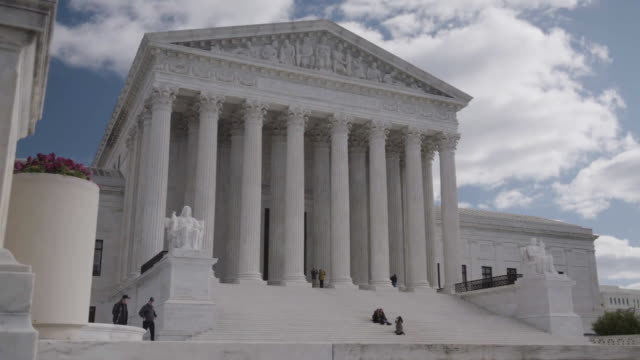 pan across the supreme court building in dc with people on the steps - supreme court stock videos & royalty-free footage