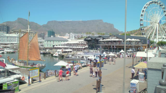 pan across the v&a waterfront in cape town, south africa - waterfront stock videos & royalty-free footage