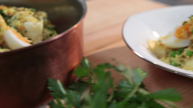 pan across to a bowl of kedgeree on a kitchen counter. - kitchen worktop stock videos & royalty-free footage