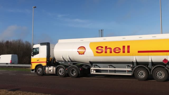 pan across to shell logo sits on totem showing the price of fuel as automobiles arrive at a gas station operated by royal dutch shell plc in utrecht... - utrecht stock videos and b-roll footage