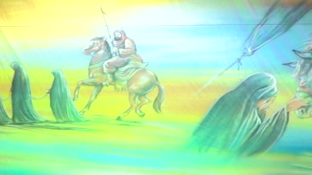 pan across traditional imagery shown during the ashura commemorations. the painting depicts several scenes from the tragedy of the battle of karbala. - ashura muharram stock videos & royalty-free footage