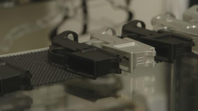 pan across various homemade gun parts, medium shot - gun stock videos & royalty-free footage