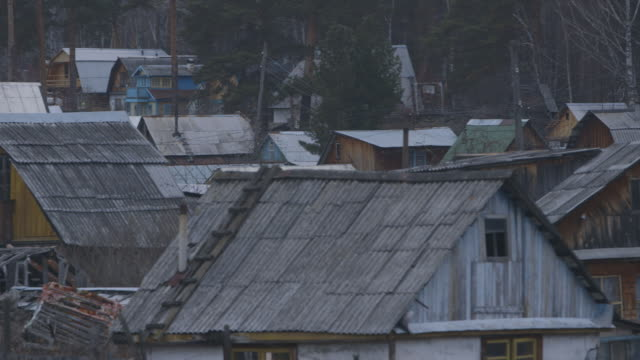 pan across village roofs in asbest, russia - asbest stock-videos und b-roll-filmmaterial
