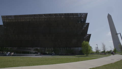 pan across washington monument and national museum of african american history and culture - museum stock videos & royalty-free footage