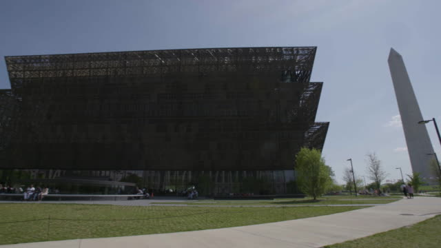 pan across washington monument and national museum of african american history and culture - smithsonian institution stock videos & royalty-free footage