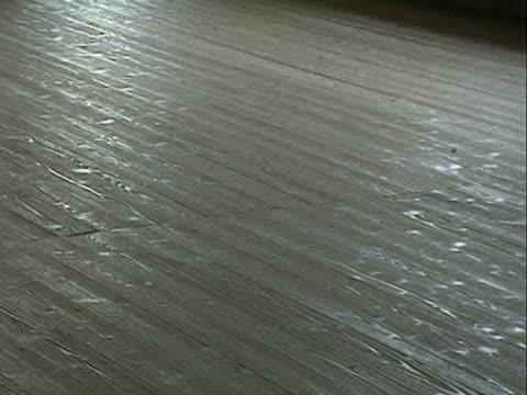 / pan along barracks wooden floor