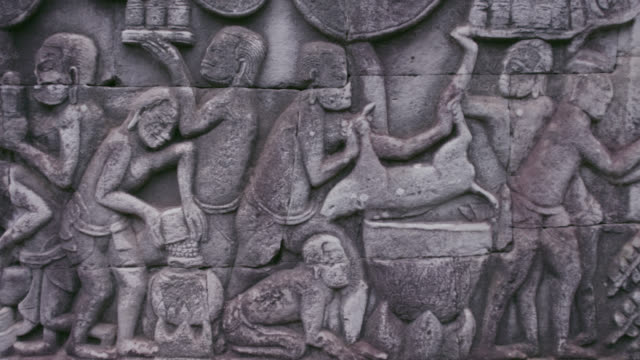 pan along bas relief in bayon, cambodia. - stone material stock videos & royalty-free footage