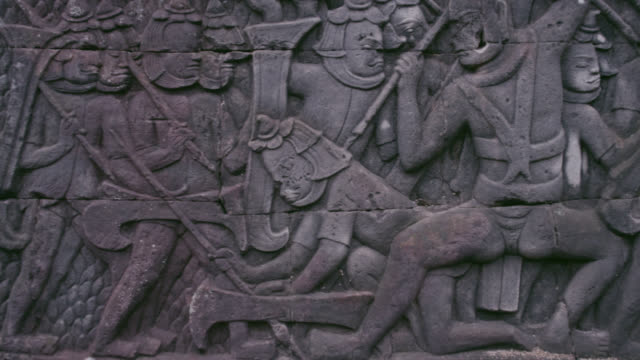 pan along bas relief in bayon, cambodia. - carving craft product stock videos & royalty-free footage
