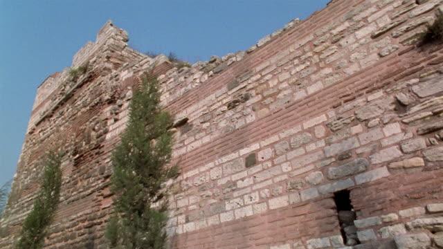 ms pan along istanbul city walls to tower/ turkey - muro video stock e b–roll