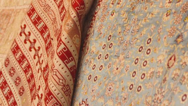 pan along oriental carpet