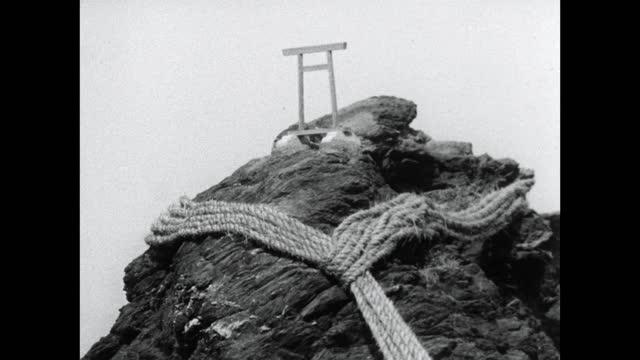 pan along rope between meoto-iwa rocks at futamiokitama shrine ;1964 - shinto shrine stock videos & royalty-free footage
